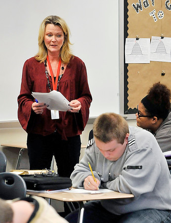 John P. Cleary   The Herald Bulletin<br /> Michele Hart, Highland Middle School eighth-grade Language Arts teacher, reads one of the student's composition as the class works on their writing skills Tuesday in class.