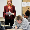 John P. Cleary | The Herald Bulletin<br /> Michele Hart, Highland Middle School eighth-grade Language Arts teacher, reads one of the student's composition as the class works on their writing skills Tuesday in class.