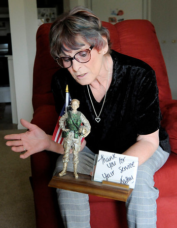 Don Knight   The Herald Bulletin<br /> Army veteran Lois Stewart has a glitter woman soldier given to her by Kathy Twitty.