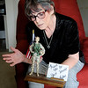Don Knight | The Herald Bulletin<br /> Army veteran Lois Stewart has a glitter woman soldier given to her by Kathy Twitty.