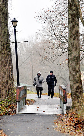 John P. Cleary | The Herald Bulletin<br /> It was a cold, blustery day for a jog but that didn't bother these two as they made their way around Shadyside Park Monday afternoon getting in their run.