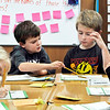 John P. Cleary | The Herald Bulletin<br /> Liam Walls and Grant Long, Lapel Elementary School second-graders in Karalee Peercy's class, work on a math problem together Monday afternoon. Both Walls and Long live in Edgewood but go to Lapel schools.
