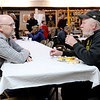 Don Knight | The Herald Bulletin<br /> From left, Tom Wilson talks to Darrell Shepperd during The Christian Center Thanksgiving meal at the Knights of Columbus on Thursday.
