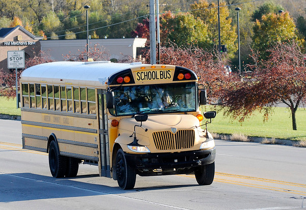 Don Knight | The Herald Bulletin A school bus turns onto Cross Street from Scatterfield while bringing kids home after the school day on Wednesday. State law requires motorists to stop when a school bus is picking up or dropping off children.