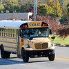 Don Knight | The Herald Bulletin<br /> A school bus turns onto Cross Street from Scatterfield while bringing kids home after the school day on Wednesday. State law requires motorists to stop when a school bus is picking up or dropping off children.