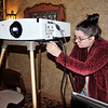 John P. Cleary | The Herald Bulletin<br /> Jacqueline Macelaru, events coordinator for the Paramount Theatre, checks over the projector they will use to start showing movies at the historic  theatre.