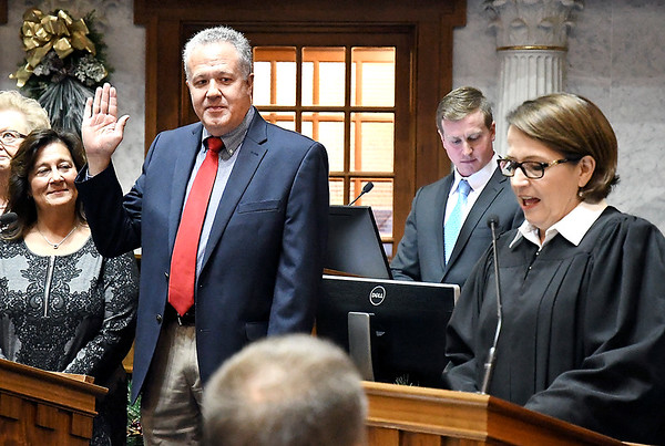 John P. Cleary | The Herald Bulletin<br /> Newly elected State Senator Mike Gaskill gets sworn in by Indiana Supreme Court Chief Justice Loretta Rush Tuesday during Organization Day at the Indiana Statehouse.