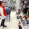 Don Knight | The Herald Bulletin<br /> Wendy Buck shops for Christmas presents at Meijer on Thanksgiving.