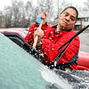 John P. Cleary | The Herald Bulletin<br /> Brenda Lightfoot works to clean off her windshield at the Madison Lakes Apartments after an ice storm hit the area overnight.