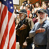 John P. Cleary | The Herald Bulletin<br /> Veterans Day program at Liberty Christian secondary campus. Veterans Anthony Dalton and Jim Harlan say the Pledge of Allegiance to the flag.