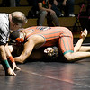 John P. Cleary | The Herald Bulletin<br /> Anderson's Venice McCullough gets ready to pin Alexandria's Remington Miller as the referee positions himself to make the call in the heavy weight class.
