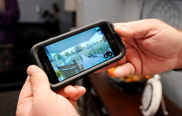 Don Knight | The Herald Bulletin<br /> Ryan Southerland can check his doorbell video camera from his smart phone.