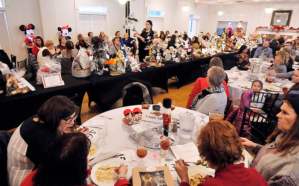 John P. Cleary | The Herald Bulletin<br /> There was a full house Tuesday at the Edgewood Golf Course & Event Center for Anderson Noon Exchange Club's Christmas Auction and Holiday Bazaar.