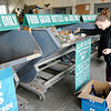 Don Knight | The Herald Bulletin<br /> Melissa Korthas recycles glass at the Madison County Recycling Center on Thursday.