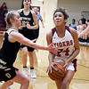 John P. Cleary | The Herald Bulletin<br /> Daleville's Mackenzie Walker tries to get a hand on the ball as Jenna Reece VanBlair, of Alexandria, drives the lane.