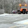 John P. Cleary | The Herald Bulletin<br /> An Anderson Street Department truck spreads salt along the Truman Bridge Thursday morning after an ice storm hit the area overnight.