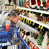 Don Knight | The Herald Bulletin<br /> Corie Marsh checks out the holiday decorations while shopping at Meijer on Thanksgiving.