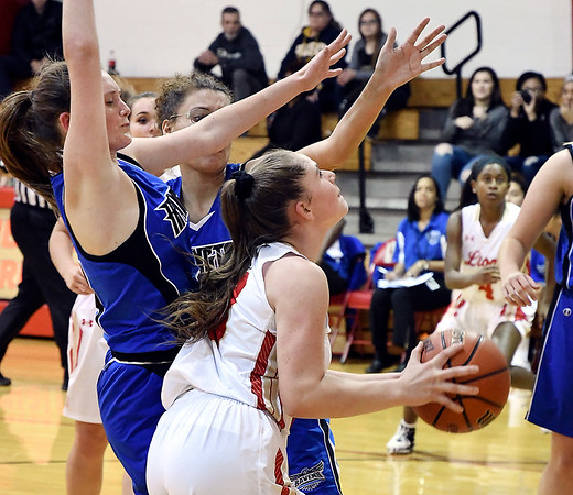John P. Cleary | The Herald Bulletin<br /> Liberty Christian's Mady Rees looks to up toward the basket as two Irvington defenders try to block from behind.