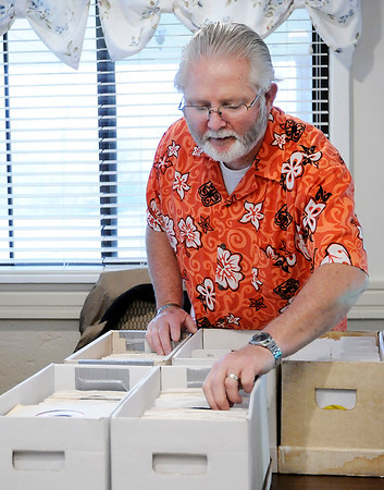 Don Knight   The Herald Bulletin<br /> Randy Humerickhouse picks his next selection from his collection of 45 records while playing them for residents at Community Northview Care Center on Thursday.
