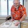 Don Knight | The Herald Bulletin<br /> Randy Humerickhouse picks his next selection from his collection of 45 records while playing them for residents at Community Northview Care Center on Thursday.