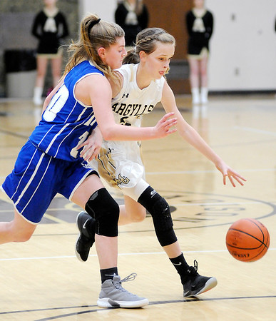 Don Knight   The Herald Bulletin<br /> Madison-Grant's Azmae Turner drives as she is guarded by Tipton's Kelsley Mitchell on Saturday.