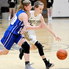 Don Knight | The Herald Bulletin<br /> Madison-Grant's Azmae Turner drives as she is guarded by Tipton's Kelsley Mitchell on Saturday.
