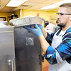 Don Knight | The Herald Bulletin<br /> David Archer pulls out a tray of stuffing to restock the serving line during the Gospel Highlight Radio Broadcast Community Thanksgiving Day Dinner at the Geater Center on Thursday.