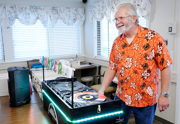 Don Knight | The Herald Bulletin<br /> Randy Humerickhouse enjoys seeing the response he gets from residents when he plays his collection of 45 records for them at Community Northview Care Center on Thursday.