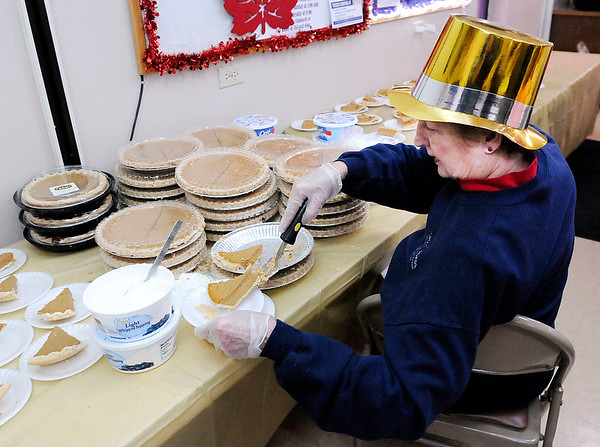 Don Knight   The Herald Bulletin<br /> Nancy Shaul keeps the dessert table stocked with slices of pumpkin pie during the annual Lawson/Wellman meal at Cross Roads United Methodist Church on Tuesday. Kathy Kellams expected to serve 400 to 500 meals.