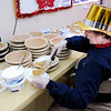 Don Knight | The Herald Bulletin<br /> Nancy Shaul keeps the dessert table stocked with slices of pumpkin pie during the annual Lawson/Wellman meal at Cross Roads United Methodist Church on Tuesday. Kathy Kellams expected to serve 400 to 500 meals.