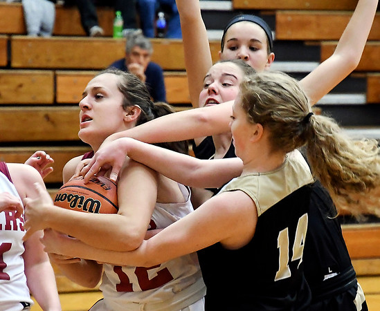 John P. Cleary | The Herald Bulletin<br /> Alexandria's Maddy Schuyler fights for control of the ball with a host of Lady Broncos.