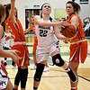 John P. Cleary | The Herald Bulletin<br /> Pendleton Heights Kailyn Graham splits Hamilton Heights defenders as she drives the lane.