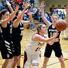 John P. Cleary | The Herald Bulletin<br /> Alexandria's Kirsten VanHorn turns and passes the ball back out after running into a wall of Daleville defenders.