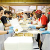 Don Knight | The Herald Bulletin<br /> From left, Bekah Snyder and Kris Lemon scoop stuffing into take out containers during the Gospel Highlight Radio Broadcast Community Thanksgiving Day Dinner at the Geater Center on Thursday.