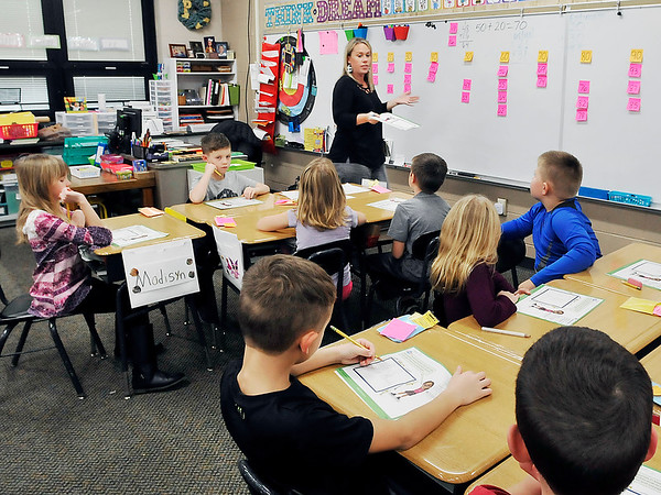John P. Cleary   The Herald Bulletin<br /> Lapel Elementary School second-grade teacher Karalee Peercy gives her students instructions as they work on math problems Monday in class.