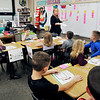 John P. Cleary | The Herald Bulletin<br /> Lapel Elementary School second-grade teacher Karalee Peercy gives her students instructions as they work on math problems Monday in class.