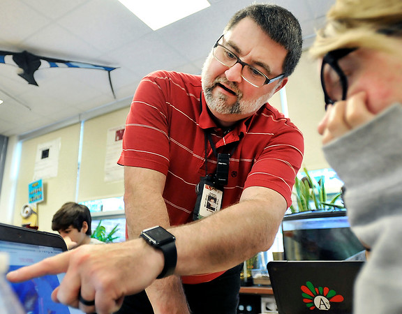 John P. Cleary   The Herald Bulletin<br /> Anderson High School English teacher Todd Callen points out an item on the screen of a student's crome book during class Monday. Callen is to be honored by the National Council of Teachers of English.