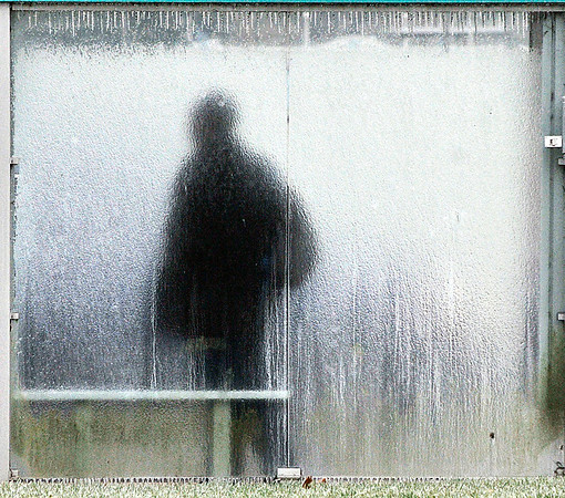John P. Cleary | The Herald Bulletin<br /> The frozen moisture on the back panel of this CATS Bus shelter blurs the silhouette of this person as they wait for their ride on University Blvd. Thursday morning after an overnight ice storm hit the area.