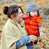 John P. Cleary | The Herald Bulletin<br /> Ronda Rhea holds her grandson Cylas as other members of the family play at Shadyside Park last week during an family outing.