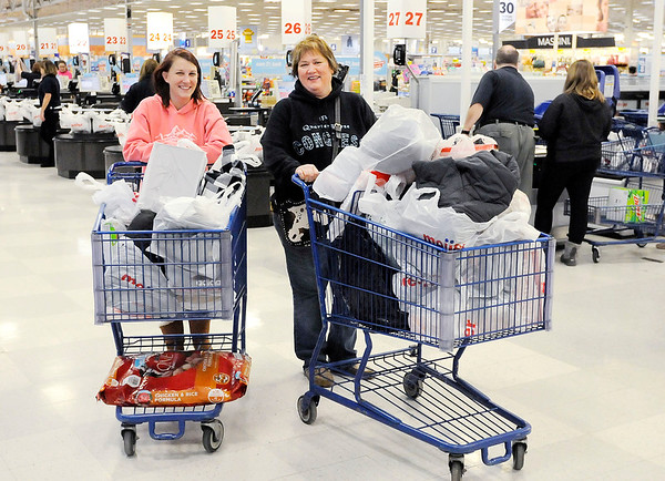 Don Knight   The Herald Bulletin<br /> From left, Nikki and Kathy Ellison leave the checkout after shopping at Meijer in Anderson on Thursday.