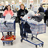 Don Knight | The Herald Bulletin<br /> From left, Nikki and Kathy Ellison leave the checkout after shopping at Meijer in Anderson on Thursday.