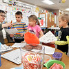 John P. Cleary | The Herald Bulletin<br /> Lapel Elementary School Kindergarten teacher Kathryn Parker checks a students paper as others wait in line for their turn.