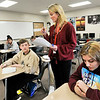 John P. Cleary | The Herald Bulletin<br /> Michele Hart, Highland Middle School eighth-grade Language Arts teacher, answers questions for her students as they work on their compositions Tuesday in class.