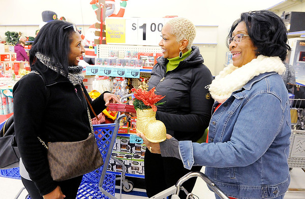Don Knight | The Herald Bulletin<br /> From left Shari Ivey of Anderson shops with her sister Zina Johnson from Louisville and mom Lena Johnson from Terre Haute at Roses on Thursday.