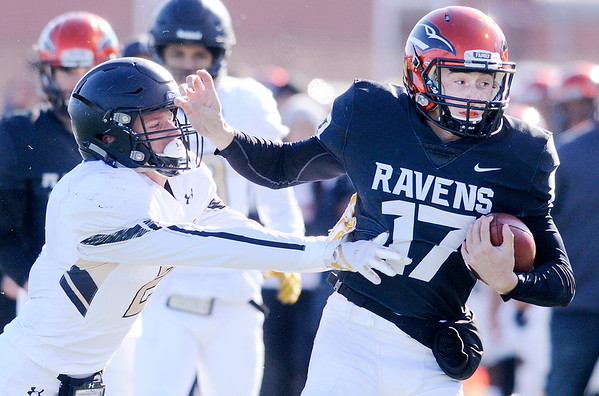 Don Knight | The Herald Bulletin Anderson University quarterback Travis McGuire is pushed out of bounds by Manchester's Nick Tillman on Saturday.