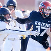 Don Knight | The Herald Bulletin<br /> Anderson University quarterback Travis McGuire is pushed out of bounds by Manchester's Nick Tillman on Saturday.