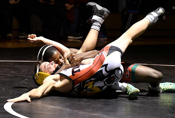 John P. Cleary   The Herald Bulletin<br /> Anderson's Romeo Williams gets an arm lock on Alexandria's Logan Flowers in the 106 pound class as he maneuvers to pin Flowers and win the match.
