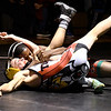 John P. Cleary | The Herald Bulletin<br /> Anderson's Romeo Williams gets an arm lock on Alexandria's Logan Flowers in the 106 pound class as he maneuvers to pin Flowers and win the match.