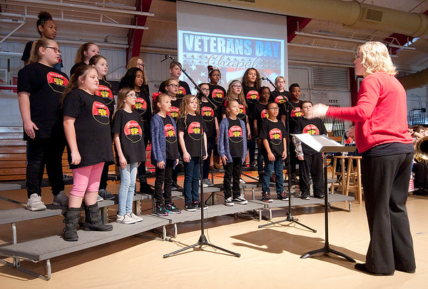 """The Lions of Judah choir performs """"American Heart"""" under the direction of Kelly McCurry during Veteran's Day Chapel at Liberty Christian Elementary School on Friday."""