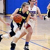 Shenandoah's Kathryn Perry drives up court as Elwood's Lexi Crosbie tries to defend her.